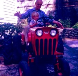 My father lets his grandson Ben take the wheel, circa 1988.