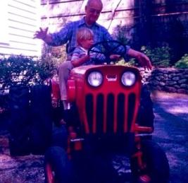 My father lets his grandson Ben take the wheel, circa 1988.