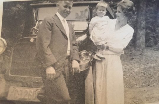 My grandmother, pictured with my grandfather and my mother at about a year old.