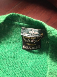 Sweater in Kelly Green, proudly purchased in Scotland, and don't you forget it, my mother seemed to say when she pinned on the errant tag for posterity.