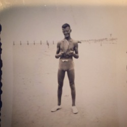 Dad, with paddle board, long before he became a dad. Circa 1935?