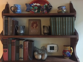Mom's books now displayed in our downstairs hallway.