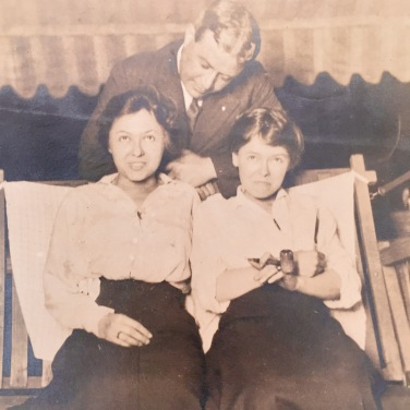 Miss Louise, right (smoking a pipe?!?), enjoying a moment of fun with her sister and an old beau. Undated but likely pre-1920.